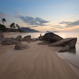 Sunrise at rocky coast of Lamai beach Royalty Free Stock Photography