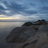Sunrise at rocky coast of Lamai beach Royalty Free Stock Images