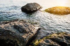 Sunrise on rocky coast Stock Image