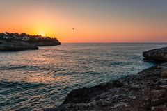 Sunrise at the rocky coast of the Spanish island Mallorca. Sunrise at the rocky coast of the Spanish island Mallorca in the Mediterranean Sea, Europe Stock Photography