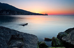 Sunrise on the rocky coastline Stock Photo