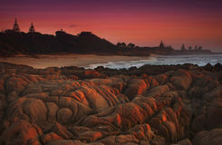 Sunrise by the rocky coastline Stock Photos