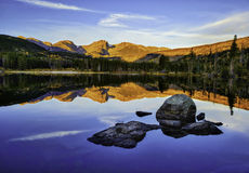 Sunrise, Rocky Mountain National Park, Colorado. Bold orange mountains are reflected in Sprague Lake at sunrise, in Rocky Mountain National Park, Colorado stock images
