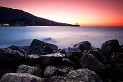 Sunrise at the rocky shore of Black sea Stock Photos