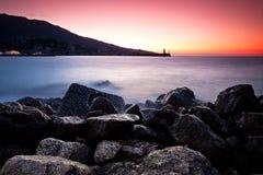 Sunrise at the rocky shore of Black sea. Yalta, Crimea, Ukraine stock photos