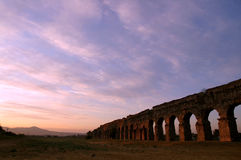 Sunrise on Roman ruins. Landscape with a sunrise over the Claudian Acqueduct ruins in Rome Stock Image