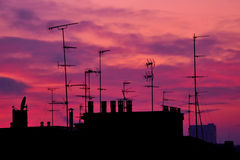 Sunrise on roofs and antennas Royalty Free Stock Image