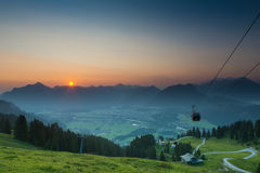 Sunrise with ropeway on mountains Royalty Free Stock Photos
