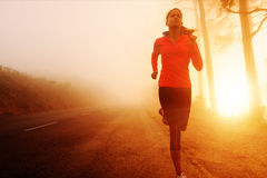 Sunrise running woman royalty free stock image