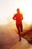 Sunrise running woman Royalty Free Stock Image