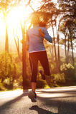 Sunrise running woman Stock Photo