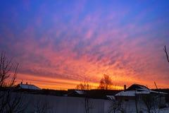 Sunrise in rural terrain. Red sunrise in rural terrain at winter length of time Royalty Free Stock Photo