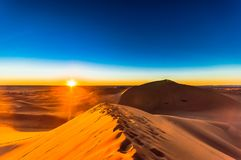 Sunrise in the Sahara desert next to M`hamid in Morocco stock photography