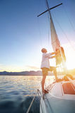 Sunrise sailing boat Stock Photos