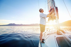 Sunrise sailing boat Royalty Free Stock Images