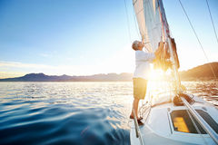 Sunrise sailing boat Stock Photography