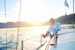 Sunrise sailing boat stock image