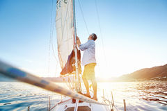 Sunrise sailing boat Royalty Free Stock Photography