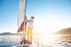 Sunrise sailing boat Royalty Free Stock Photo