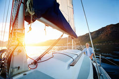 Sunrise sailing boat Stock Images