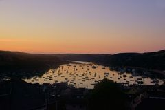 Sunrise at Salcombe Harbour, Devon, UK. Salcombe is a popular resort town in the South Hams district of Devon, south west England. The town is close to the mouth stock photography