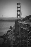 Sunrise in San Fran. The fog was rolling in, and the sun was gleaming through, and the bridge stood in its majesty Royalty Free Stock Photos