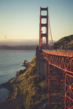 Sunrise in San Fran. The fog was rolling in, and the sun was gleaming through, and the bridge stood in its majesty Royalty Free Stock Image