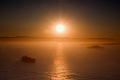 Sunrise in San Francisco with Alcatraz and ship royalty free stock photos