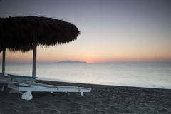 Sunrise on Santorini, Greece. Sunrise and beach scene on Santorini, Greece Stock Image