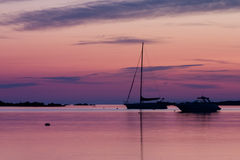 Sunrise in Sardegna. A fishing boat in shallow water on a quiet morning before sunrise Royalty Free Stock Photo