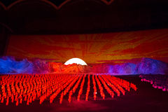 Sunrise scene at Arirang Mass Games DPRK. Sunrise scene with dancers put into a red light at the Arirang Mass Games Stock Photos