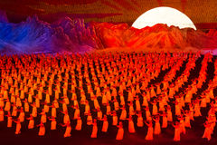 Sunrise scene at Arirang Mass Games DPRK. Sunrise scene with dancers put into a red light at the Arirang Mass Games Royalty Free Stock Photo