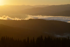 Sunrise scene in mountains Stock Images