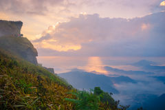 Sunrise scene with the peak of mountain and cloudscape. At Phu chi fa in Chiangrai Province,Thailand royalty free stock image