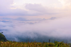Sunrise scene with the peak of mountain and cloudscape. At Phu chi fa in Chiangrai Province,Thailand royalty free stock photography