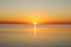 Sunrise in sea. In orange Stock Photography