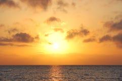 Sunrise in sea. Orange sunrise in dark sea Stock Photography