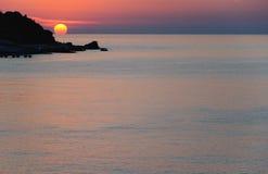 Sunrise on the sea. Rocky sea coast Stock Image