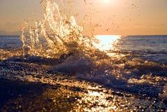 Sunrise at sea. Sea spray water at dawn in Crimea stock photo