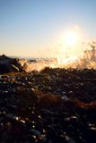 Sunrise at sea. Sea spray water at dawn in Crimea Stock Images