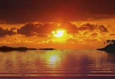 Sunrise at sea. With far land and trees Royalty Free Stock Image