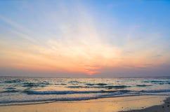 Sunrise at sea. On beach Royalty Free Stock Photo