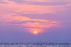 Sunrise at sea. On beach Royalty Free Stock Images