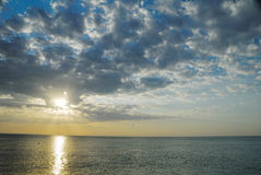 Sunrise on the sea. Many clouds in the sky royalty free stock photography