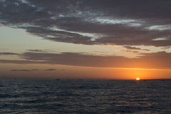 Sunrise on the sea, Bali. Sunrise with the sun in the sea off the coast of Bali, Indonesia Stock Images