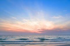Sunrise at sea. On beach Royalty Free Stock Photography