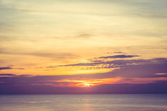 Sunrise and Sea. Beautiful sunrise on sky with beach and sea - Vintage filter Processing Royalty Free Stock Photography