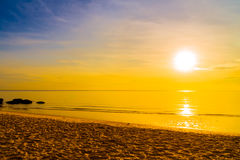 Sunrise and Sea. Beautiful sunrise on sky with beach and sea - Vintage filter Processing Stock Photography