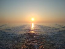 Sunrise at sea. A beautifull sunrise at a fishing vessel Royalty Free Stock Photography