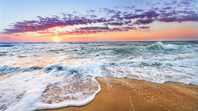 Sunrise in the sea. Blue sky Royalty Free Stock Photography